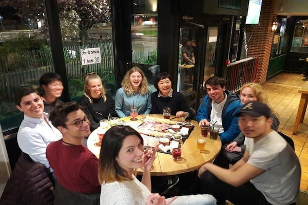 Students at an evening meal at a restaurant in Rouen