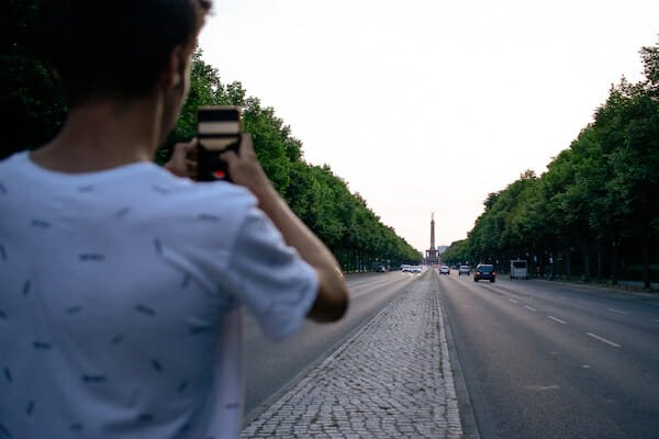 Student taking photo of monument in Berlin