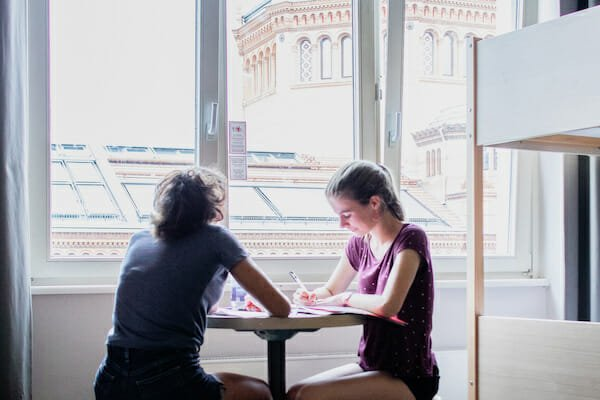 Two students studying in their dorm room at the student residence, Berlin German Language School, Germany
