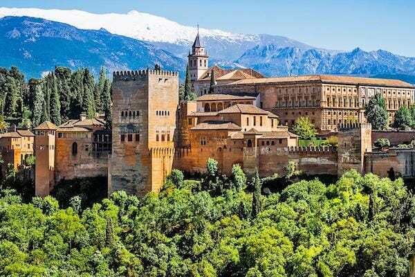 The Alhambra, Granada with the Sierra Nevada mountains behind covered in snow