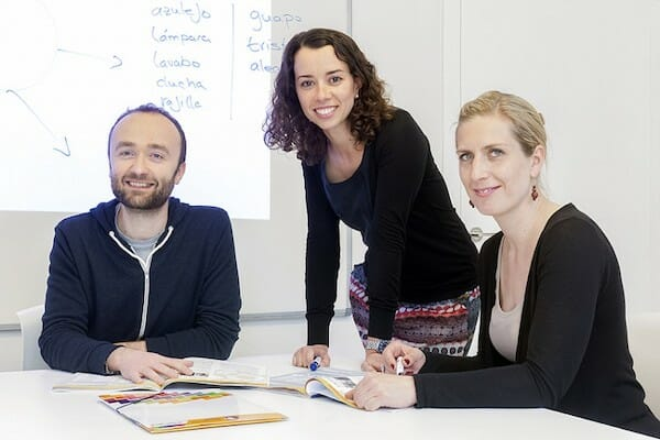 Two teachers learning from their Spanish teacher